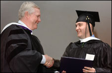 photo: Jack presents diploma to Luis